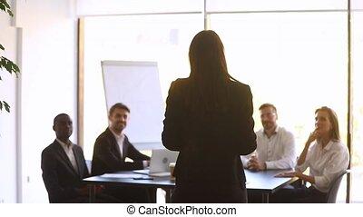Female leader motivate team applauding celebrate business success, rear view