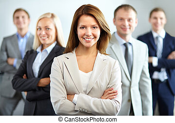 Female leader - Portrait of a smiling business woman looking...