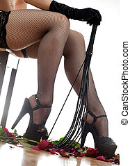 female legs and whip - Beautiful female legs in red...