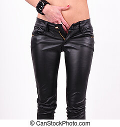 female legs in black trousers on white background. - female ...
