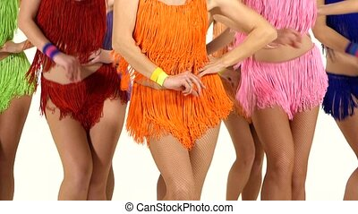 Female legs in dance. Close up. Dresses of different colors....