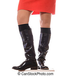 Female legs in high brown leather boots  isolated on white