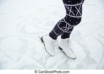 Female legs in ice skates