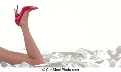 Female legs in red heels. Glossy shoes on high heel. Master...