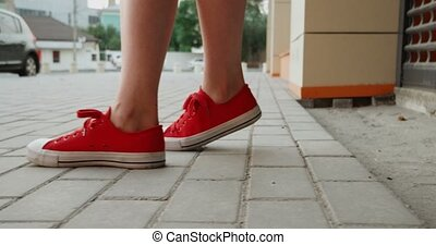 Female Legs In Red Trainers Make Steps On Pavement Side Vie ...