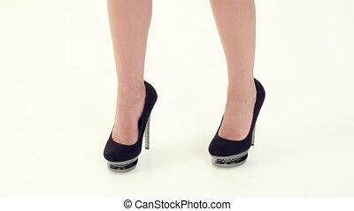 female legs on high heels dancing.