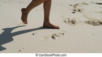 Female Legs Walking On Sand Closeup, Woman Bear Feet Steps...