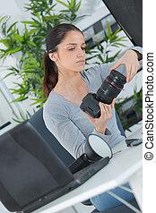 female lens technician
