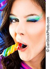 Female licking lollipop blink