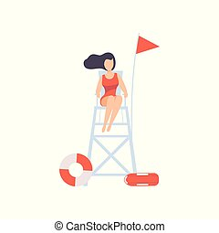Female lifeguard sitting on lookout tower, professional...