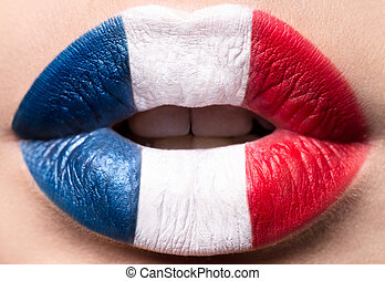 Female lips close up with a picture flag of France. Blue, white, red.