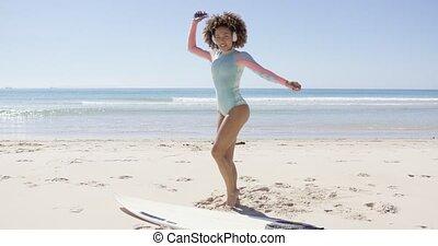 Female listening to music on beach