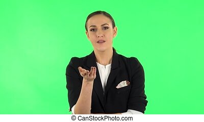 Female listens attentively and nods his head pointing finger at viewer. Green screen