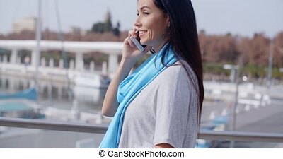 Female looking over shoulder while on phone - Cute young...