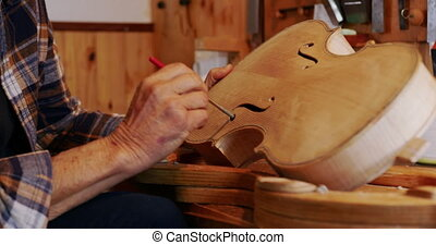 Female luthier at work in her workshop - Side view close up ...