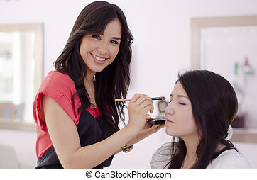 Female makeup artist at work