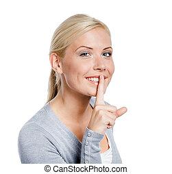 Female making silence gesture