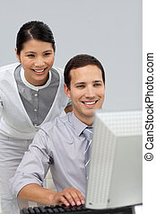 Female manager checking her employee\'s work