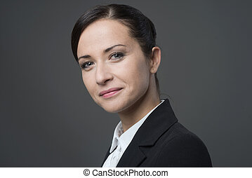 Female manager portrait smiling at camera