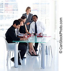 Female manager with her team in office - Mature female...