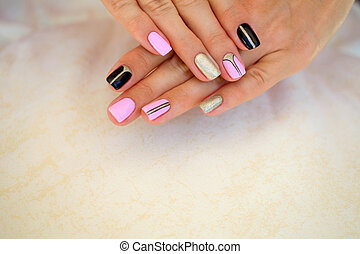 Female manicure with beautiful design the drawing (shellac).