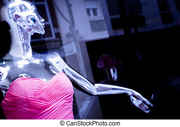 Female mannequin in red dress