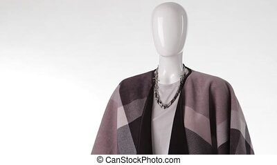 Female mannequin wearing long shawl. Warm shawl and trendy...