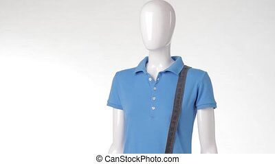Female mannequin wearing polo t-shirt. Blue t-shirt and...