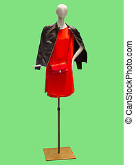 Female mannequin wearing red dress and leather jacket.