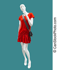 Female mannequin wearing red dress.