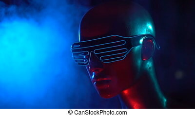 Female mannequin with neon led glasses - Closeup face of...