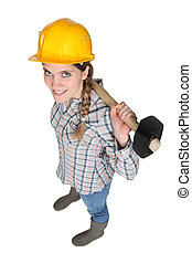 Female manual worker holding a sledge hammer
