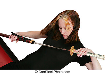 female martial artist with sword - attractive beautiful...