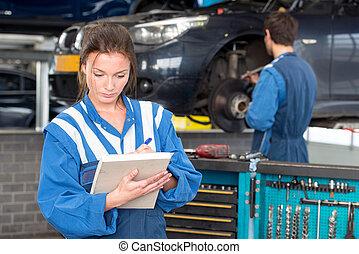 Female mechanic at work