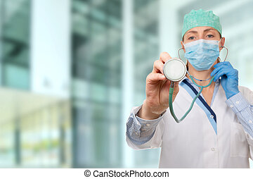 Female medical doctor holding a stethoscope