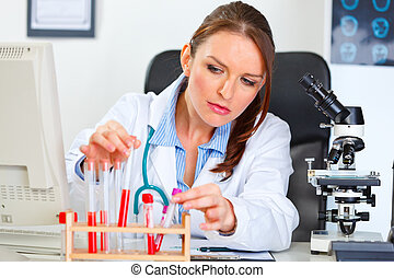 Female medical doctor working with test tube in laboratory