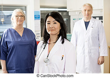 Female Medical Professional Standing With Team