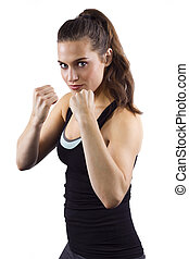 Female MMA Fighter - young woman in fighting stance on white...