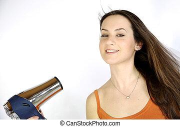 Female model blow drying her long brunette hair