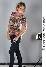 Female model doing a studio photo shoot