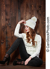 Female model posing over wooden background