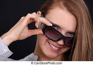 Female model with sunglasses.