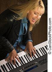 Female Musician Performs - Femal Musician Sings While ...