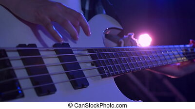 Female musician tuning her guitar before concert - Close up ...