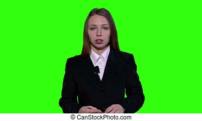 Female Newsreader is wearing a jacket and talking