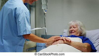 Female nurse adjusting iv drip 4k - Side view of Caucasian ...