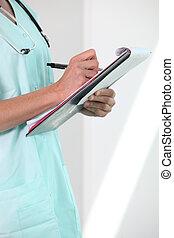 Female nurse holding clipboard and pen