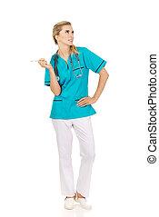 Female nurse holding gauze and scissors