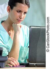 Female nurse with laptop