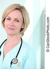 Female nurse with stethoscope around neck